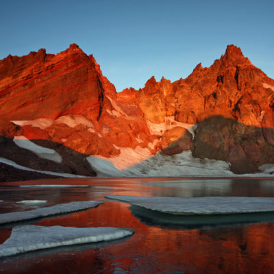 Sunrise at the glacial lake on the east face of Broken Top in the Three Sisters Wilderness in Oregon.