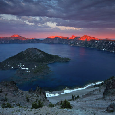 Sunset illuminates Mount Scott and Garfield Peak at Crater Lake National Park in Oregon.