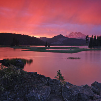 Post-thunderstorm clouds light up Sparks Lake and South Sister in central Oregon.