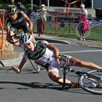 A rider crashes while rounding a corner during the criterium of the USA Cycling U23 Road Nationals in downtown Bend, Oregon.