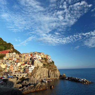 Manarola as perched on a rocky cliff along the Mediterranean Sea in Italy.