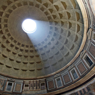 Light shines through the oculus of the Pantheon's dome in Rome, Italy.