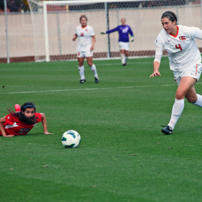 Arizona's Susana Melendez slides past Oregon State's Erin Uchacz during a soccer match in Corvallis, Oregon.