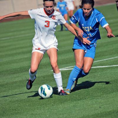 Oregon State's Jenna Richardson battles UCLA's Lucretia Lee for the ball during a soccer match in Corvallis, Oregon.